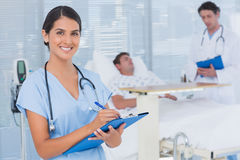 Doctors taking care of patient royalty free stock photography