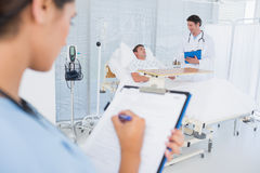 Doctors taking care of patient stock image