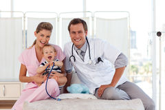 Doctors taking care of a young child Royalty Free Stock Photo