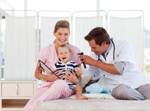 Doctors taking care of a young child Royalty Free Stock Images