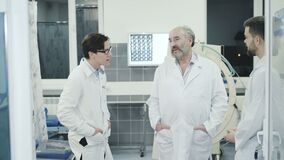 Doctors takling with co-worker on break in the rest room in hospital. 4K stock footage