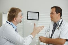 Doctors talking Stock Images