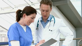 Doctors talking in the hallway stock footage