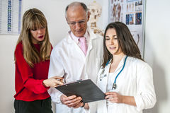 Doctors. Talking about a patient with his documents Stock Photo