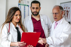 Doctors. Talking about a patient with his documents Royalty Free Stock Image