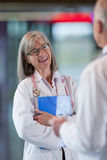 Doctors talking together in hospital hallway royalty free stock image