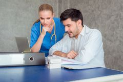 Doctors team examining medical reports at hospital office. Healthcare concept royalty free stock photography