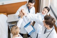 Doctors team giving highfive Stock Photos