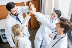 Doctors team giving highfive Stock Images