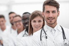 Doctors team showing finger in camera royalty free stock images