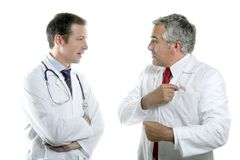 Doctors team talking expertise senior tie Stock Photos