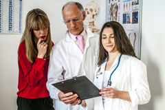 Doctors team. Talking about a patient Stock Photo