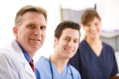 Doctors: Team of Three Medical Professionals Royalty Free Stock Image
