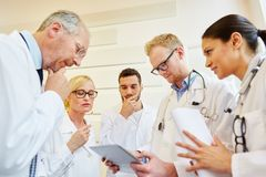 Doctors thinkg about problem. Doctors thinkg about therapy problem and brainstorming stock photo