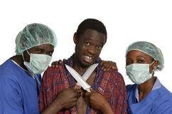 Doctors threaten patient with knifes Stock Photos