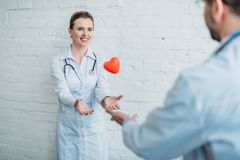doctors throwing toy heart to royalty free stock photography