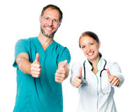 Doctors with thumbs up Royalty Free Stock Photography