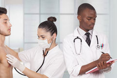 Doctors treat patient. Young doctors treating a patient Royalty Free Stock Image