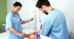 Doctors treating a patient. In the hospital stock footage