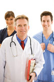 Doctors: Trustworthy Health Professional Team Stock Photo