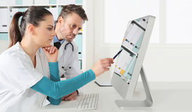 Doctors use the computer, concept of medical consulting. In office royalty free stock photography