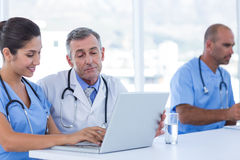 Doctors using computer Stock Photo