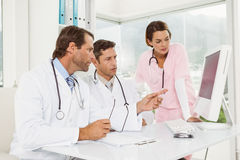 Doctors using computer at medical office Royalty Free Stock Photography