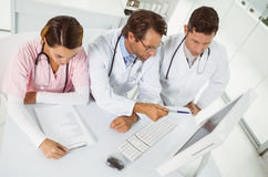 Doctors using computer at medical office Royalty Free Stock Images