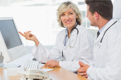 Doctors using computer at medical office Royalty Free Stock Photo