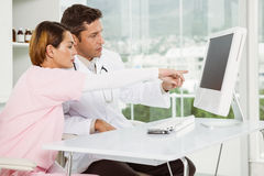 Doctors using computer at medical office Royalty Free Stock Image