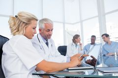 Doctors using a laptop Royalty Free Stock Image