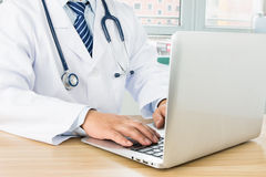 Doctors using laptop Stock Photo