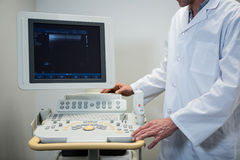 Doctors using sonography machine. In hospital stock image