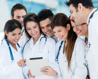 Doctors using a tablet computer Stock Photo