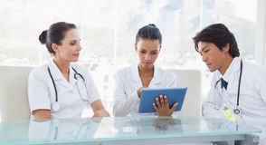 Doctors using a tablet pc Stock Photography