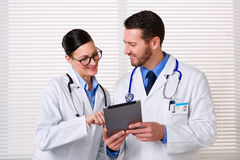 Doctors using tablet at work stock photo