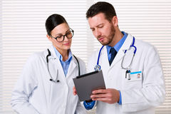 Doctors using tablet at work Stock Image