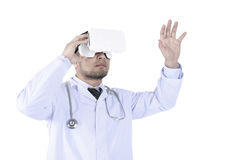 Doctors are using a VR headset to check medical information.  Royalty Free Stock Images