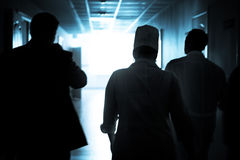 Doctors walking down the hall to save a life Stock Photos