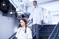 Doctors walking down stairs Royalty Free Stock Image