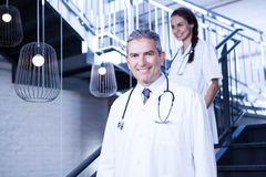 Doctors walking down stairs Stock Photo