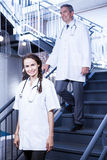 Doctors walking down stairs Stock Image