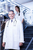 Doctors walking down stairs Royalty Free Stock Photography