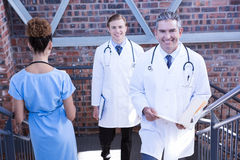 Doctors walking on staircase Stock Photography