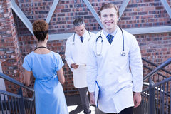 Doctors walking on staircase Stock Images