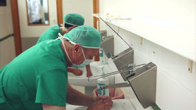 Doctors washing hands stock footage