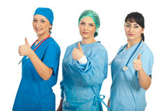 Doctors women giving thumbs Royalty Free Stock Photos