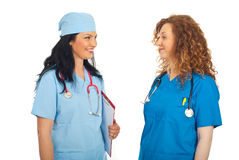 Doctors women having happy conversation Royalty Free Stock Image