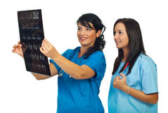 Doctors women review magnetic resonance Royalty Free Stock Images
