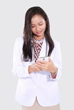 Doctors women who use smart phones Stock Photo